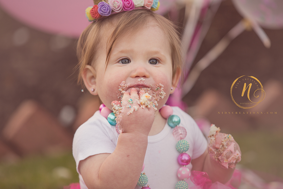 cake face baby birthday shoot